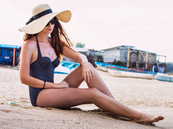 Summer photoshoot at the beach, polka dots retro swimsuit, sunhat