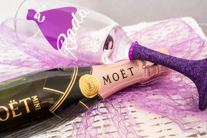It is a Mells World Bridesmaids Box Invitation Moet Rose Mini Purple Champagne PersonalisedGlass